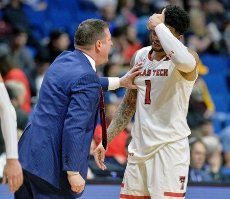 Mar 22, 2019; Tulsa, OK, USA; Texas Tech Red Raiders head coach Chris Beard talks with guard Brandone Francis (1) during a time out after he committed a foul in the first round of the 2019 NCAA Tournament at BOK Center. The Texas Tech Red Raiders won 72-57. Mandatory Credit: Brett Rojo-USA TODAY Sports