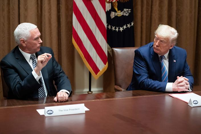 Vice President Mike Pence talks to President Trump speaks during a roundtable meeting on seniors in the Cabinet Room of the White House on Monday. (Photo by Saul Loeb/AFP via Getty Images)