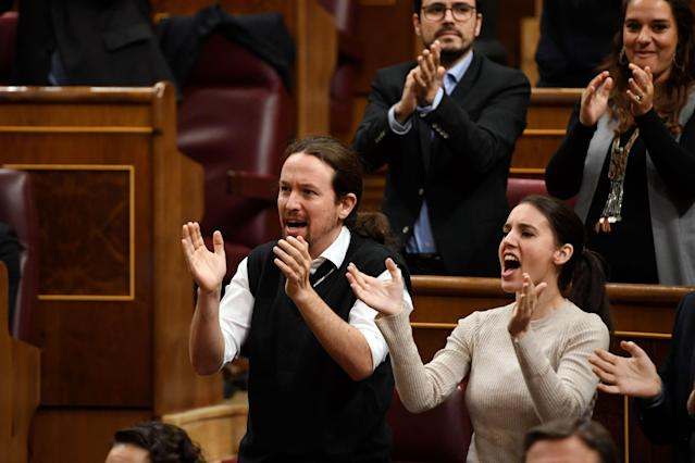 Far left wing Podemos party leader, Pablo Iglesias (L) and MP Irene Montero (Photo by PIERRE-PHILIPPE MARCOU/AFP via Getty Images)