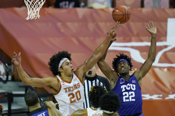 TCU guard RJ Nembhard (22) is blocked by Texas forward Jericho Sims (20) during the first half of an NCAA college basketball game, Saturday, Feb. 13, 2021, in Austin, Texas. (AP Photo/Eric Gay)