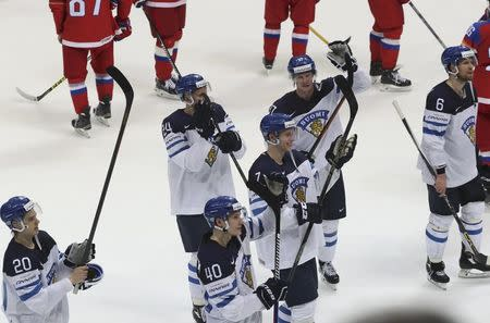 Ice Hockey - 2016 IIHF World Championship - Semi-final - Finland v Russia - Moscow, Russia - 21/5/16 - Players of Finland applaud their fans after the game. REUTERS/Grigory Dukor