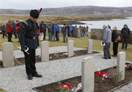 Local residents and British Falklands War veterans gather to pay homage to the British soldiers who died during the conflict at the San Carlos cemetery in the Falklands Islands June 13, 2012.