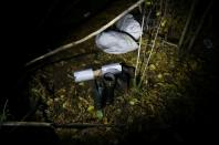 Belongings of group of migrants after they cross Belarusian-Polish border are pictured in the woods near Sokolka