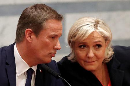 Marine Le Pen French National Front (FN) political party leader and candidate for French 2017 presidential election and Debout La France group former candidate Nicolas Dupont-Aignan attend a news conference in Paris, France, April 29, 2017. REUTERS/Charles Platiau