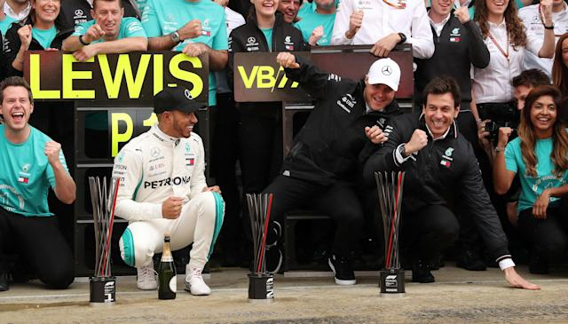 Formula One F1 - Spanish Grand Prix - Circuit de Barcelona-Catalunya, Barcelona, Spain - May 13, 2018 Mercedes' Lewis Hamilton and Valtteri Bottas celebrate with their team and Executive Director Toto Wolff (R) after finishing first and second respectively REUTERS/Albert Gea