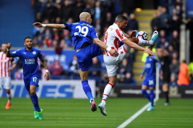 Leicester City's Yohan Benalouane (C) vies with Stoke City's Jonathan Walters (R) during their match at King Power Stadium in Leicester, central England on April 1, 2017