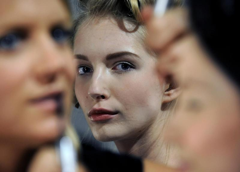 A model waits backstage before the showing of the Billy Reid Spring 2013 collection during Fashion Week, Friday, Sept. 7, 2012, in New York. (AP Photo/Louis Lanzano)