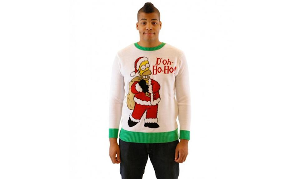"""<p>Santa Homer says, """"D'oh Ho Ho!"""" <strong><a rel=""""nofollow noopener"""" href=""""http://www.uglychristmassweater.com/product/the-simpsons-homer-doh-ho-ho-adult-off-white-sweater/"""" target=""""_blank"""" data-ylk=""""slk:Buy here"""" class=""""link rapid-noclick-resp"""">Buy here</a></strong> </p>"""