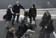 Members of a WHO team arrives in Wuhan in central China's Hubei province on Thursday, Jan. 14, 2021. The global team of researchers arrived Thursday in the Chinese city where the coronavirus pandemic was first detected to conduct a politically sensitive investigation into its origins amid uncertainty about whether Beijing might try to prevent embarrassing discoveries. (AP Photo/Ng Han Guan)