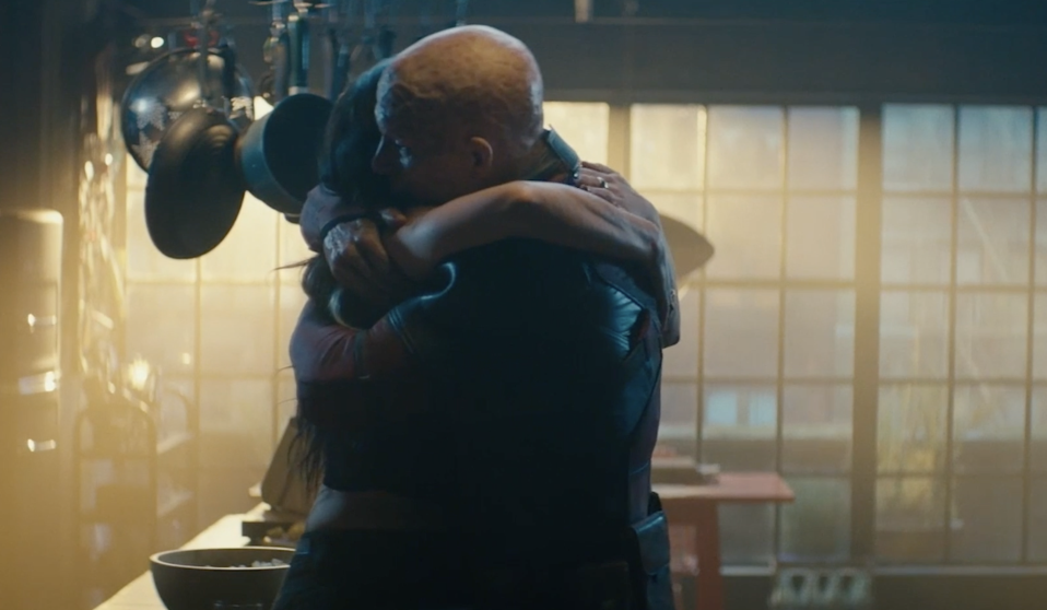 Vanessa (Morena Baccarin) and Wade (Ryan Reynolds) embrace moments before her untimely end in <i>Deadpool 2</i>. (Photo: FOX)