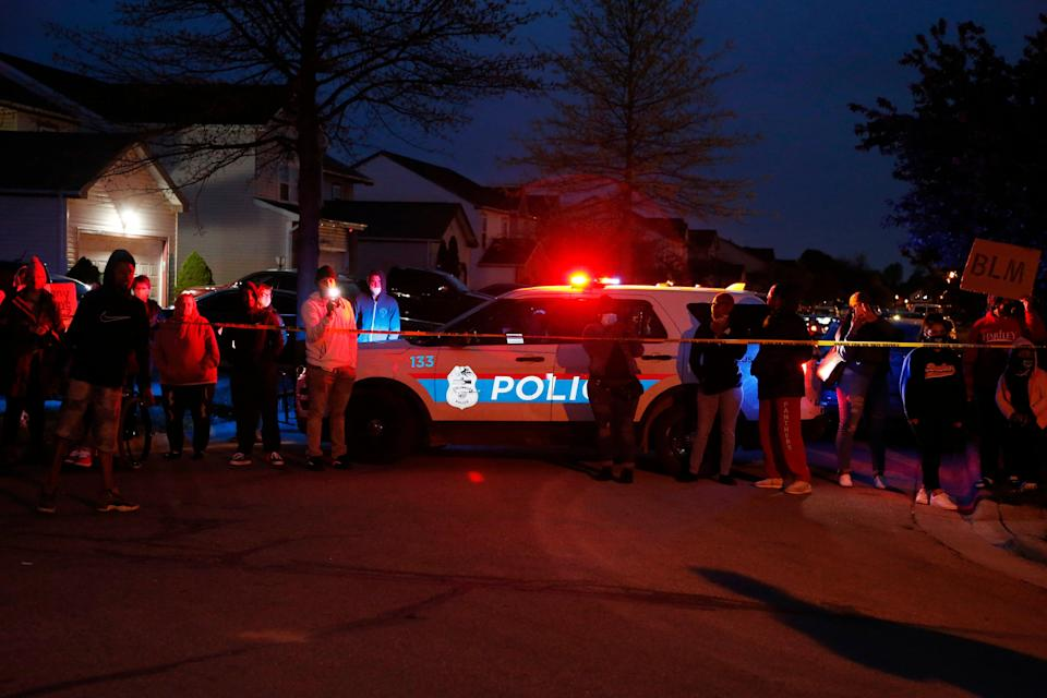 <p>A crowd gathers to protest in the neighbourhood where a Columbus police officer fatally shot a teenage girl on Tuesday</p> (AP)