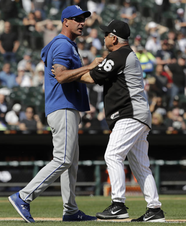 Kansas City Royals bench coach Dale Sveum, left, and Chicago White Sox manager Rick Renteria shove each other as benches clear after Chicago White Sox's Tim Anderson was hit by a pitch during the sixth inning of a baseball game in Chicago, Wednesday, April 17, 2019. The Royals won 4-3. (AP Photo/Nam Y. Huh)