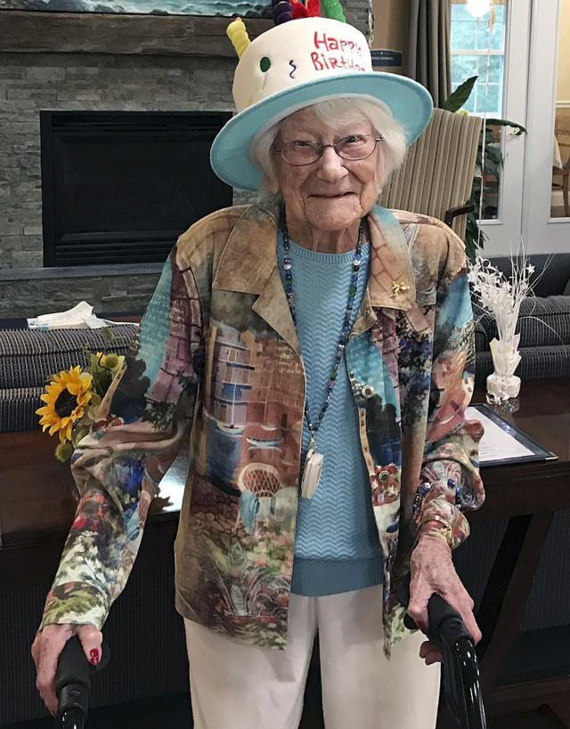 In this photo provided by Tony Venti, Hazel Nilson celebrates her 111th birthday, Wednesday, Aug. 21, 2019, at Sunapee Cove in Sunapee, N.H. A lifelong Chicago Cubs fan, Nilson was born on Aug. 21, 1908, in Chicago. (Tony Venti via AP)