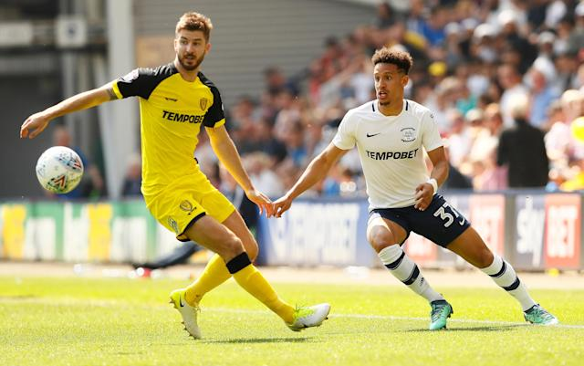 "Soccer Football - Championship - Preston North End vs Burton Albion - Deepdale, Preston, Britain - May 6, 2018 Burton Albion's Luke Murphy in action with Preston North End's Callum Robins Action Images/Jason Cairnduff EDITORIAL USE ONLY. No use with unauthorized audio, video, data, fixture lists, club/league logos or ""live"" services. Online in-match use limited to 75 images, no video emulation. No use in betting, games or single club/league/player publications. Please contact your account representative for further details."