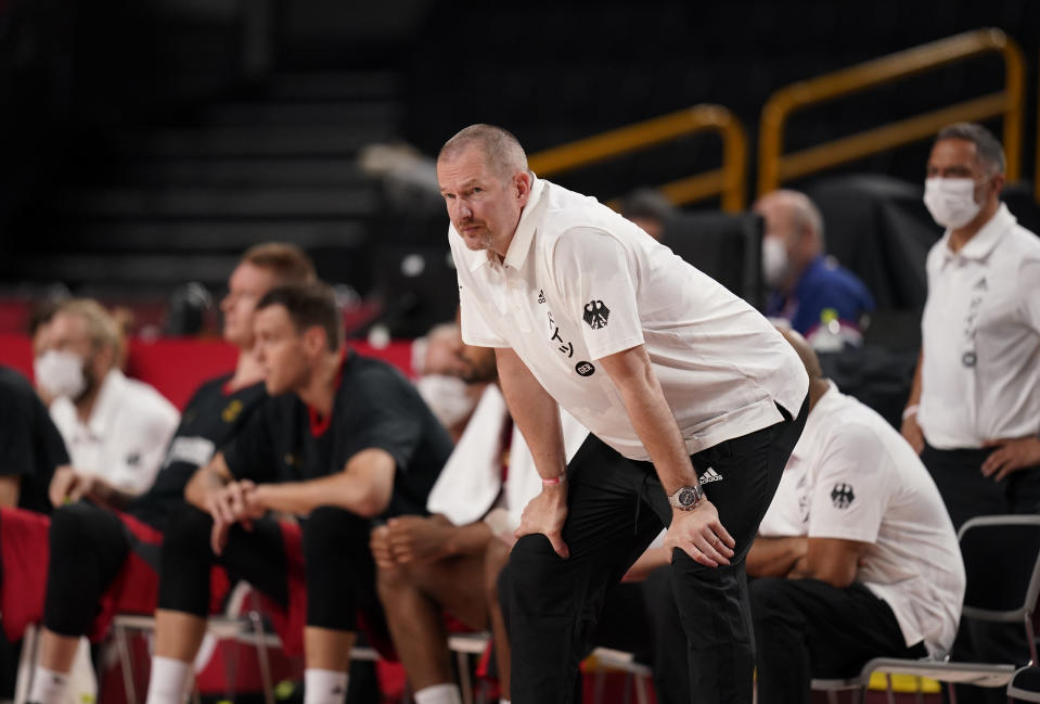 Germany's head coach Henrik Roedl watches during men's basketball preliminary round game against Nigeria at the 2020 Summer Olympics, Wednesday, July 28, 2021, in Saitama, Japan. (AP Photo/Charlie Neibergall)