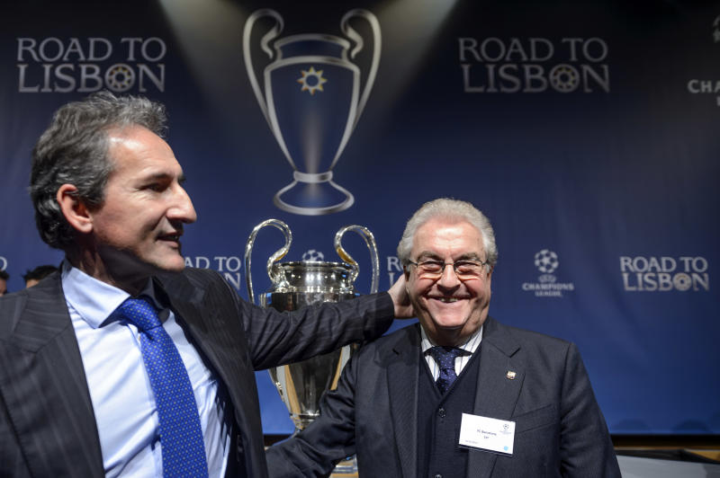 Manchester City football director Txiki Begiristain, left, poses with former FC Barcelona vice-president and grandfather to Gerard Pique, Amador Bernabeu, right, after the draw of the round of 16 games of UEFA Champions League 2013/14 at the UEFA Headquarters in Nyon, Switzerland, Monday, Dec.16, 2013. (AP Photo/Keystone,Laurent Gillieron)