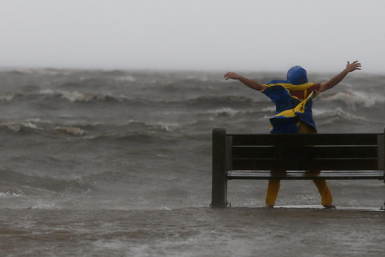 NEW ORLEANS, LA - AUGUST 28:  A man stands in the high winds on the edge of  Lake Pontchatrain as Hurricane Isaac approaches on August 28, 2012 in New Orleans, Louisiana.  Hurricane Isaac is expected to make landfall later today along the Lousiana coast.  (Photo by Chris Graythen/Getty Images)