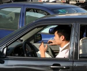 Guy smoking in a car