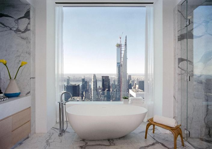 Western view from a bathroom from one of theupper floor staged apartments at Rafael Viñoly's432 Park Avenue.