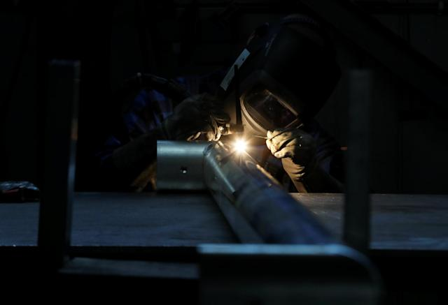 A worker welds the aluminium part of a goal at at Interplastic, a Polish manufacturing company who are supplying the football goalposts for the 2018 World Cup finals in Russia, in Chwaszczyno, Poland, May 16, 2018. Picture taken May 16, 2018. REUTERS/Kacper Pempel