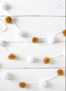 """<p>This fun, yet dainty garland doesn't require any fancy craft supplies like a pom-pom maker—you can make each one using a fork (really!) and some yarn. </p><p><a href=""""https://abeautifulmess.com/diy-holiday-garlands-5-ways/"""" rel=""""nofollow noopener"""" target=""""_blank"""" data-ylk=""""slk:Get the tutorial."""" class=""""link rapid-noclick-resp"""">Get the tutorial.</a></p><p><a class=""""link rapid-noclick-resp"""" href=""""https://www.amazon.com/HEART-Super-Saver-Yarn-White/dp/B000XZY8Q4?tag=syn-yahoo-20&ascsubtag=%5Bartid%7C10072.g.37499128%5Bsrc%7Cyahoo-us"""" rel=""""nofollow noopener"""" target=""""_blank"""" data-ylk=""""slk:SHOP YARN"""">SHOP YARN</a></p>"""