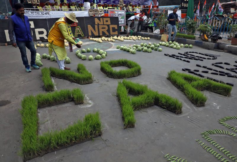 Demonstrators arrange agricultural products as part of a protest against a new citizenship law, in Kolkata
