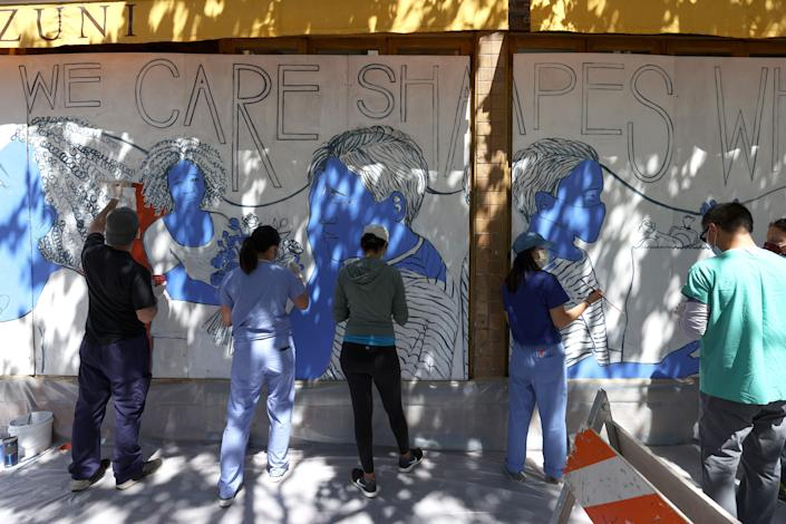 Painting a mural to honor medical workers on June 22, 2020, in San Francisco.