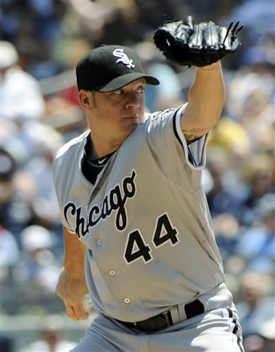 Chicago White Sox starter Jake Peavy delivers a pitch to the New York Yankees during the first inning of a baseball game, Saturday, June 30, 2012, at Yankee Stadium in New York. (AP Photo/Bill Kostroun)