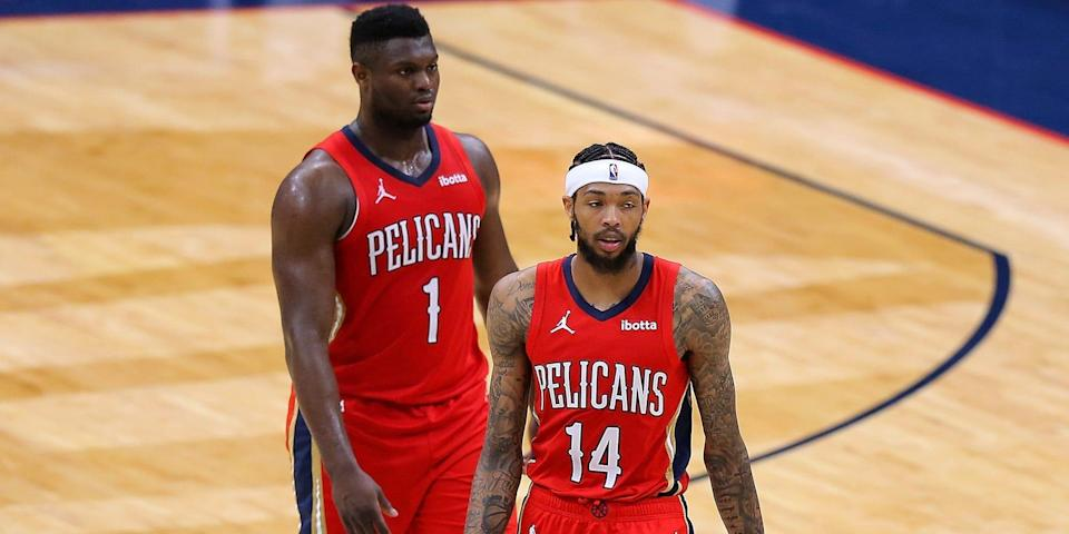 Brandon Ingram walks in front of Zion Williamson during a game in March 2021.