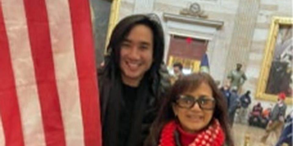 Accused Capitol rioter Antony Vo and his mother stand with US flag