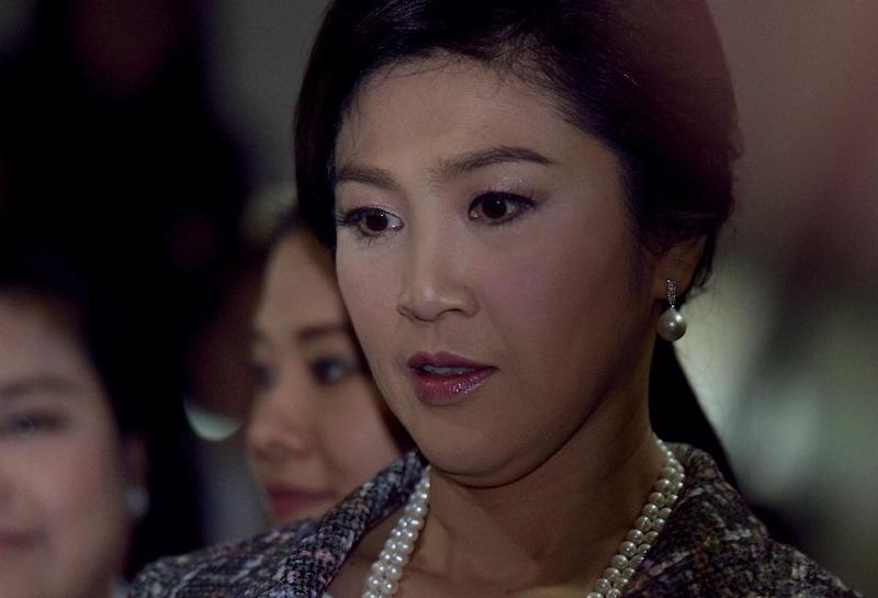 Former Thai premier Yingluck Shinawatra is formally indicted over a bungled rice subsidy scheme in the latest legal move against her polarising family that could see her jailed for up to a decade (AFP Photo/Pornchai Kittiwongsakul)