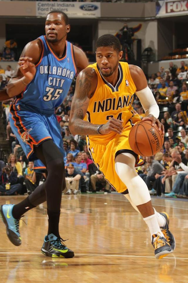 INDIANAPOLIS - APRIL 13: Paul George #24 of the Indiana Pacers handles the ball against the Oklahoma City Thunder at Bankers Life Fieldhouse on April 13, 2014 in Indianapolis, Indiana. (Photo by Ron Hoskins/NBAE via Getty Images)