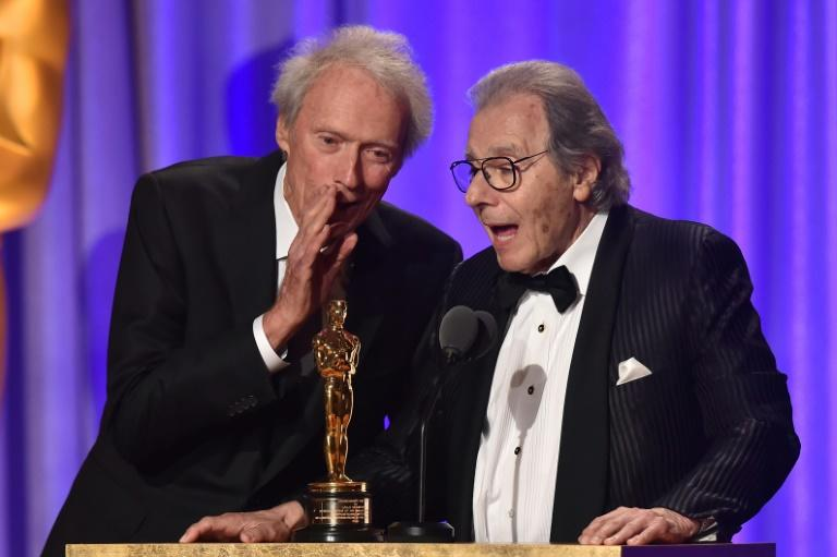 """US actor Clint Eastwood (L) starred in """"Dirty Harry,"""" one of the numerous films for which Argentinian composer Lalo Schifrin (R) wrote scores"""