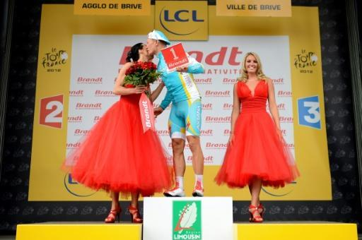 Kazakstan's Alexandre Vinokourov kisses a hostess as he celebrates on the podium his combativity prize at the end of the 222.5 km and eighteenth stage of the 2012 Tour de France cycling race in Brive-la-Gaillarde, France, on July 20, 2012