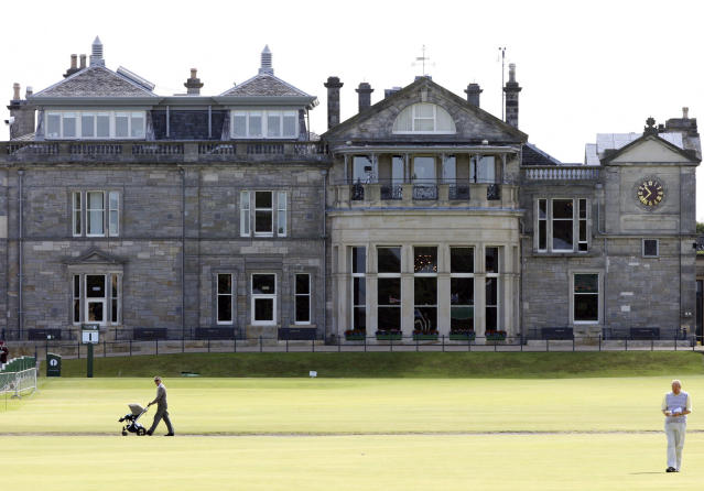 FILE - This July 7, 2010 file photo shows a view of the clubhouse at the end of the fairway on the first hole on the Old course at St Andrews golf course in St Andrews, Scotland. Wednessday, July 7, 2010. Alastair Johnston of IMG is donating his entire library, the largest in the world for golf, to the Royal & Ancient Golf Club. (AP Photo/Scott Heppell, file)