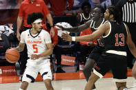 Illinois guard Andre Curbelo (5) is defended by Nebraska forwards Lat Mayen and Derrick Walker (13) during the first half of an NCAA college basketball game Thursday, Feb. 25, 2021, in Champaign, Ill. (AP Photo/Holly Hart)