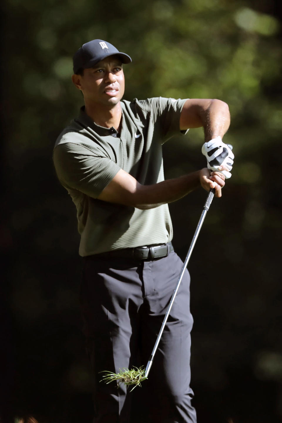 Tiger Woods reacts after teeing off on the 11th hole during the first round of the Masters golf tournament Thursday, Nov. 12, 2020, in Augusta, Ga. (Curtis Compton/Atlanta Journal-Constitution via AP)