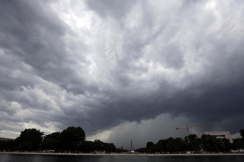 Dark clouds are seen as a storm moves through the area with the Washington Monument in the background, Thursday, June 13, 2013, in Washington. (AP Photo/Alex Brandon)