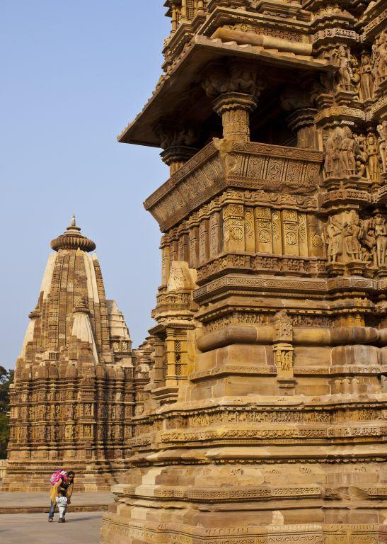 Visitors are dwarfed by the enormity of the temples in Khajuraho.