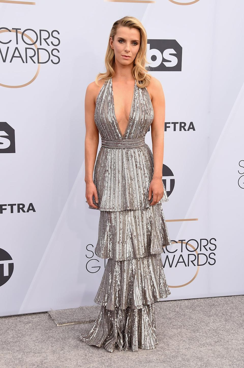 <p>Wearing a silver tiered gown by Krikor Jabotian with Alexandre Birman heels and Beladora jewels.</p>