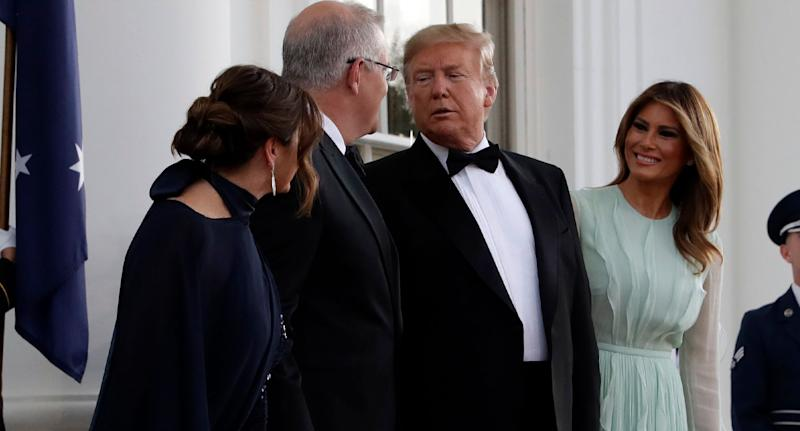 Scott Morrison and Donald Trump chat as wives watch on at White House for the state dinner.