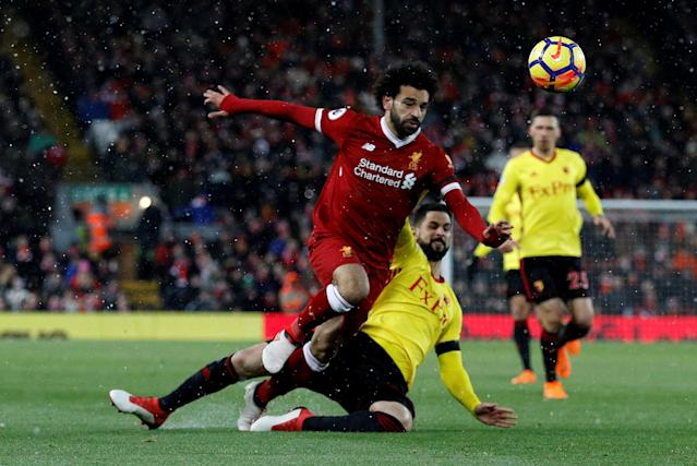 "Soccer Football - Premier League - Liverpool vs Watford - Anfield, Liverpool, Britain - March 17, 2018 Watford's Miguel Angel Britos in action with Liverpool's Mohamed Salah REUTERS/Phil Noble EDITORIAL USE ONLY. No use with unauthorized audio, video, data, fixture lists, club/league logos or ""live"" services. Online in-match use limited to 75 images, no video emulation. No use in betting, games or single club/league/player publications. Please contact your account representative for further details."