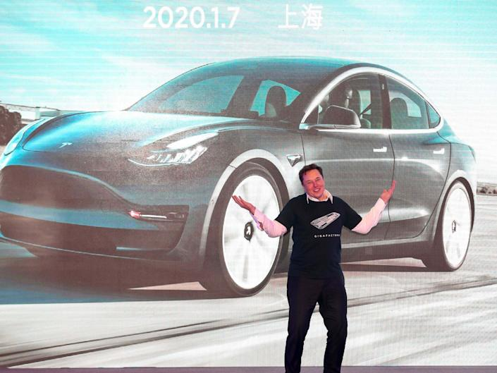 Tesla CEO Elon Musk gestures during the Tesla China-made Model 3 Delivery Ceremony in Shanghai: AFP via Getty Images