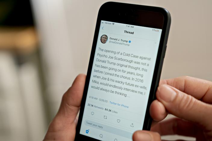 A Joe Scarborough tweet by U.S. President Donald Trump is displayed on a smartphone on May 26, 2020. (Andrew Harrer/Bloomberg via Getty Images)