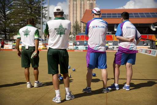 From left, second Hadyn Evans and lead Philip Jones of Norfolk Island, and lead Ronald Duncan and second Derek Oliver of Scotland watch the action during their men's triples semifinal lawn bowling match at the Broadbeach Bowls Club during the 2018 Commonwealth Games on the Gold Coast, Australia, Sunday, April. 8, 2018. The Norfolk team won the bronze medal with a 19-16 victory over Canada, securing the islands second medal ever at the Commonwealth Games. (AP Photo/Mark Schiefelbein)