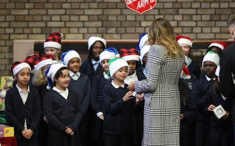 US First Lady Melania Trump during a visit to the Salvation Army Clapton Centre in London - Credit: Yui Mok/PA