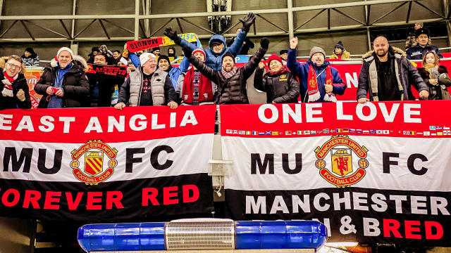 Travelling United fans braving the -15C temperatures (Photo by Ash Donelon/Manchester United via Getty Images)