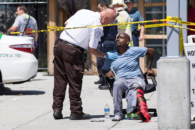 <p>Emergency personnel looks over a victim at the scene where a cab jumped a curb striking several bystanders near the Logan International Airport taxi pool in Boston, MA, July 3, 2017. (Keith Bedford/The Boston Globe via Getty Images) </p>