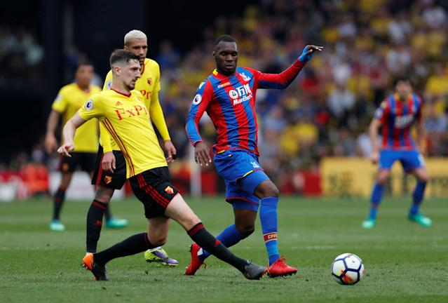 """Soccer Football - Premier League - Watford v Crystal Palace - Vicarage Road, Watford, Britain - April 21, 2018 Crystal Palace's Christian Benteke in action with Watford's Craig Cathcart Action Images via Reuters/Paul Childs EDITORIAL USE ONLY. No use with unauthorized audio, video, data, fixture lists, club/league logos or """"live"""" services. Online in-match use limited to 75 images, no video emulation. No use in betting, games or single club/league/player publications. Please contact your account representative for further details."""
