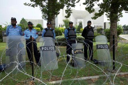 Policemen stand guard outside the Supreme Court building during Panama leaks hearing in Islamabad